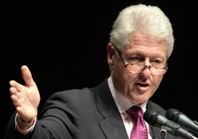 Former President of the United States Bill Clinton speaks to attendees at The U.S. Conference of Mayors in Seattle
