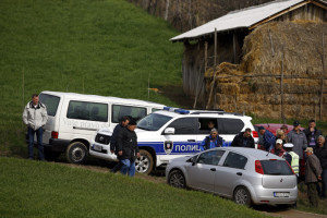 Police and residents are pictured in the village of Velika Ivanca