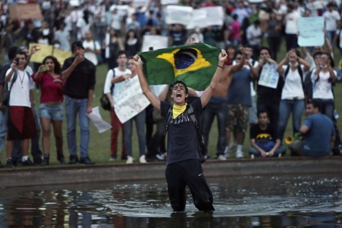 A demonstrator with the Brazilian flag protests against the Confederation's Cup and the government of Brazil's President Dilma Rousseff in Brasilia