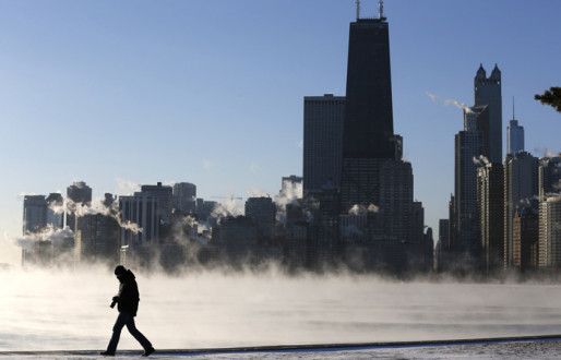 Man silhouetted against arctic smoke rising off Lake Michigan in Chicago