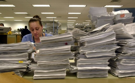 387803 05: An Internal Revenue Service employee processes tax returns in the mail room April 12, 2001 at the IRS East Coast headquarters in Brookhaven, New York. As the deadline for tax filing approaches, the IRS is now offering a variety of payment options, including e-mail and credit cards. (Photo by Spencer Platt/Newsmakers)