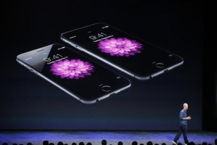 Apple CEO Tim Cook speaks during an Apple event announcing the iPhone 6 and the iPhone 6 Plus at the Flint Center in Cupertino