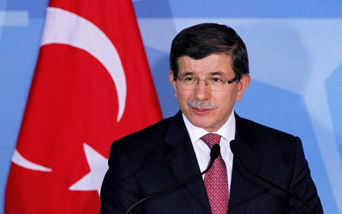 Turkey's Foreign Minister Ahmet Davutoglu addresses a news conference after meeting NATO Secretary General Anders Fogh Rasmussen (not pictured) at the Alliance's headquarters in Brussels January 18, 2012.      REUTERS/Francois Lenoir (BELGIUM - Tags: POLITICS MILITARY)