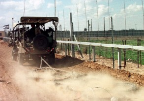 ARMY SAFARI VEHICLE SMOOTHS DIRT ALONG GAZA BORDER FENCE