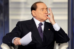 Italy's former Prime Minister Silvio Berlusconi gestures as he appears as a guest on the RAI television show Porta a Porta (Door to Door) in Rome January 9, 2013. Berlusconi has little chance of destabilising a centre-left government after Italy's February election and outgoing premier Mario Monti is the most likely to become kingmaker, one of Italy's top experts on voting trends said on Wednesday.  REUTERS/Remo Casilli  (ITALY - Tags: POLITICS MEDIA)