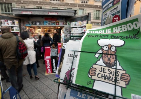 People queue for the new issue of satirical French weekly Charlie Hebdo at a kiosk in Nice