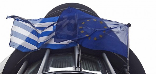 Greek national flag and a European Union flag flutter outside the Greek embassy in Brussels