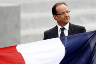 France's President Francois Hollande leaves after the traditional Bastille Day military parade in Paris