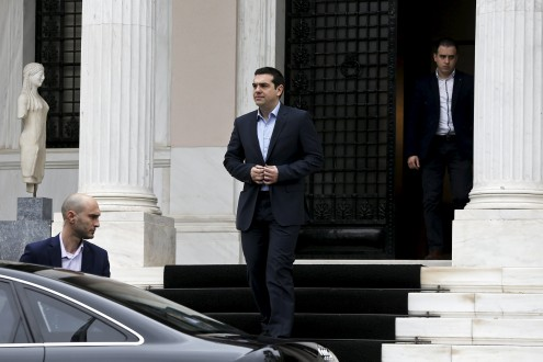 Greek PM Tsipras leaves his office in Maximos Mansion after a meeting with his government's financial staff in Athens
