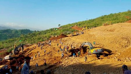 People look for the bodies of miners killed by a landslide in Kachin state