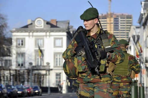 Belgian soldiers guard outside the U.S. Embassy in Brussels, near the Belgian Parliament