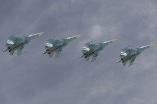 Sukhoi Su-34 Fullback tactical bombers fly in formation over the Red Square during the Victory Day parade in Moscow