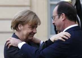 French President Hollande welcomes Germany's Chancellor Merkel as she arrives at the Elysee Palace before the solidarity marchin the streets of Paris