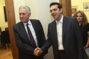 Leader of the Left Coalition party Tsipras meets leader of Democratic Left party Kouvelis in Athens