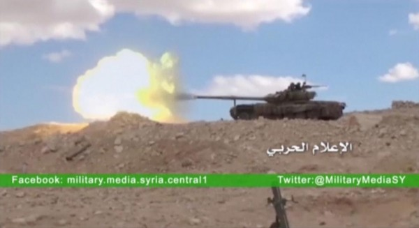 A tank fires at where the Syrian military media said is Palmyra, in this still image taken from a Syrian military media video