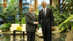 U.S. President Barack Obama and Cuba's President Raul Castro shake hands in Havana