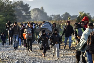 Migrants and refugees cross Macedonia on their way to EU