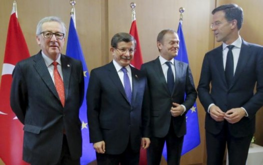 Turkish PM Davutoglu poses with EU Commission President Juncker, EU Council President Tusk and Netherlands' PM Rutte during a EU leaders summit in Brussels
