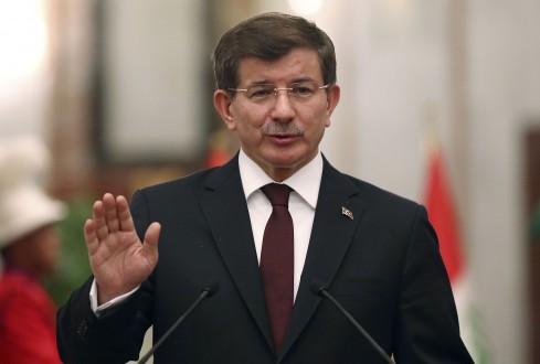 Turkey's Prime Minister Davutoglu speaks at a news conference with Iraqi Prime Minister Haider al-Abadi in Baghdad
