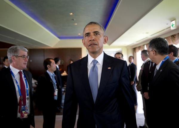 U.S. President Barack Obama arrives late to participate in a G-7 Working Session in Shima