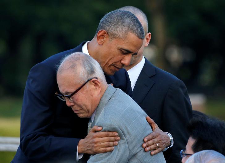 U.S. President Barack Obama hugs with atomic bomb survivor Shigeaki Mori as he visits Hiroshima Peace Memorial Park in Hiroshima, Japan