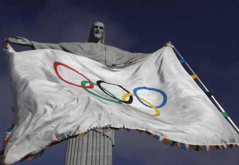 "The Olympic Flag flies in front of ""Christ the Redeemer"" statue during a blessing ceremony in Rio de Janeiro"