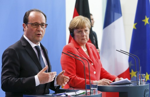 French President Hollande and German Chancellor Merkel address a news conference at the Chancellery in Berlin