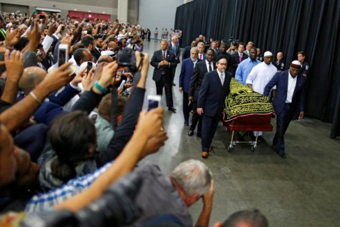 Worshipers and well-wishers take photographs as the casket with the body of the late boxing champion Muhammad Ali is brought for his jenazah, an Islamic funeral prayer, in Louisville