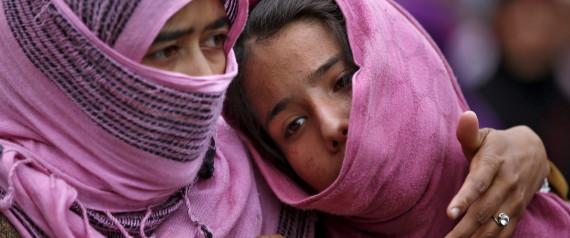 Kashmiri Muslim girls attend the funeral of Bilal Ahamd, a suspected militant, in Karimabad village in south Kashmir