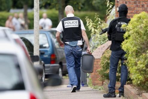 Members of French special police forces of Research and Intervention Brigade (BRI) and French judicial investigating police are seen at the scene during a raid after a hostage-taking in the church in Saint-Etienne-du-Rouvray