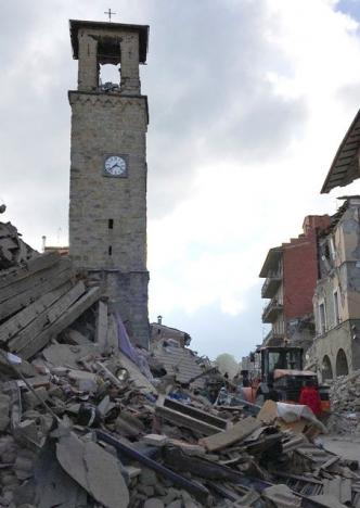 The partially damaged tower bell with the clock signing the time of the earthquake is seen in Amatrice