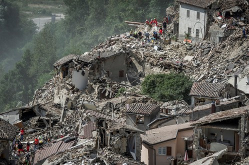 Rescuers work following an earthquake in Pescara del Tronto