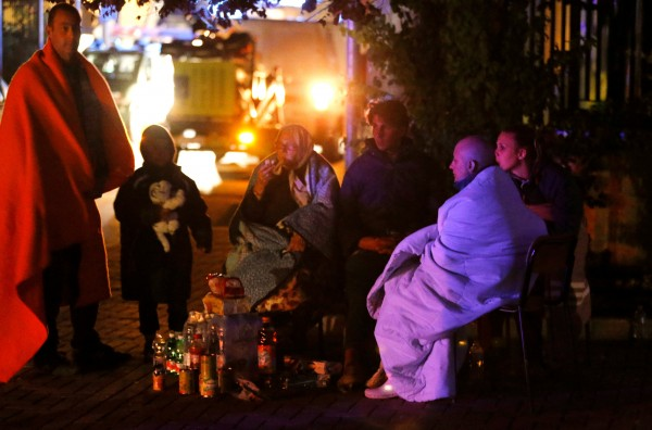 People prepare to spend the night in the open following an earthquake in Amatrice