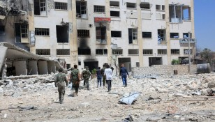 Government troops claim neighborhoods of Aleppo