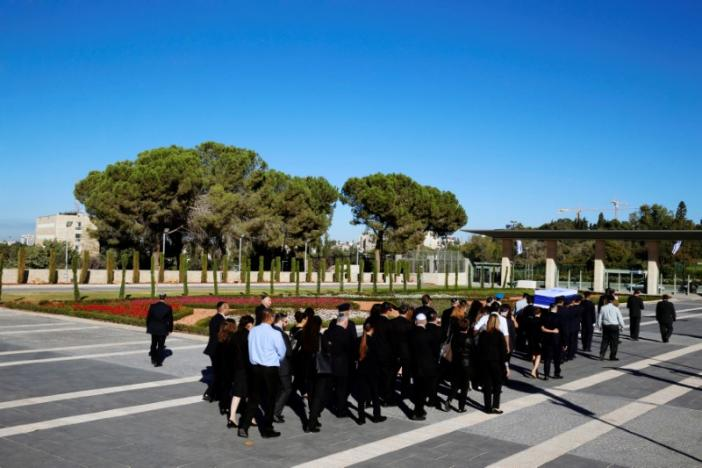 Family members of former Israeli President Shimon Peres walk behind his flag-draped coffin during a ceremony at the Knesset, the Israeli parliament, before it is transported to Mount Herzl Cemetery ahead of the funeral in Jerusalem