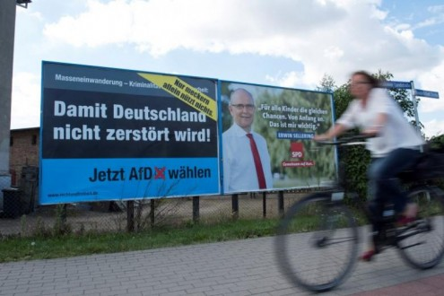 Election posters of the right-wing Alternative for Germany (AfD) and Social Democratic Party (SPD) are seen in Greifswald