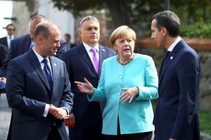 Maltese Prime Minister Muscat, Hungary's Prime Minister Orban, Germany's Chancellor Merkel and Austria's Chancellor Kern arrive to pose for a family photo during the European Union summit- the first one since Britain voted to quit- in Bratislava