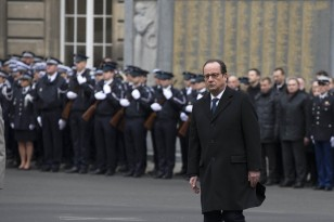 French President Hollande attends a national tribute for the three police officers killed during last week's Islamic attacks, at Paris Prefecture in Paris