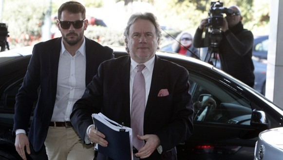 Greek Labour Ministry George Katrougalos arrives for a meeting with the heads of the institutions' representatives of Greece's lenders in Athens