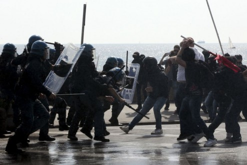 Italian police clash with demonstrators during a protest against Prime Minister Matteo Renzi during a visit to the southern city of Naples