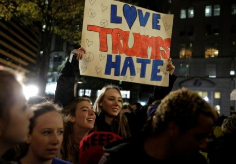 Demonstrators protest against U.S. President-elect Donald Trump in front of the Trump International Hotel in Washington