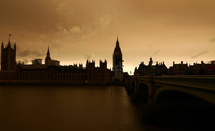 Clouds gather over a view of westminster in London, Britain