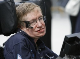 British cosmologist Stephen Hawking smiles as he answers questions about his up coming ZERO-G flight during an interview at Kennedy Space Center, Florida