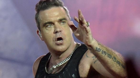 English-singer-Robbie-Williams-performs